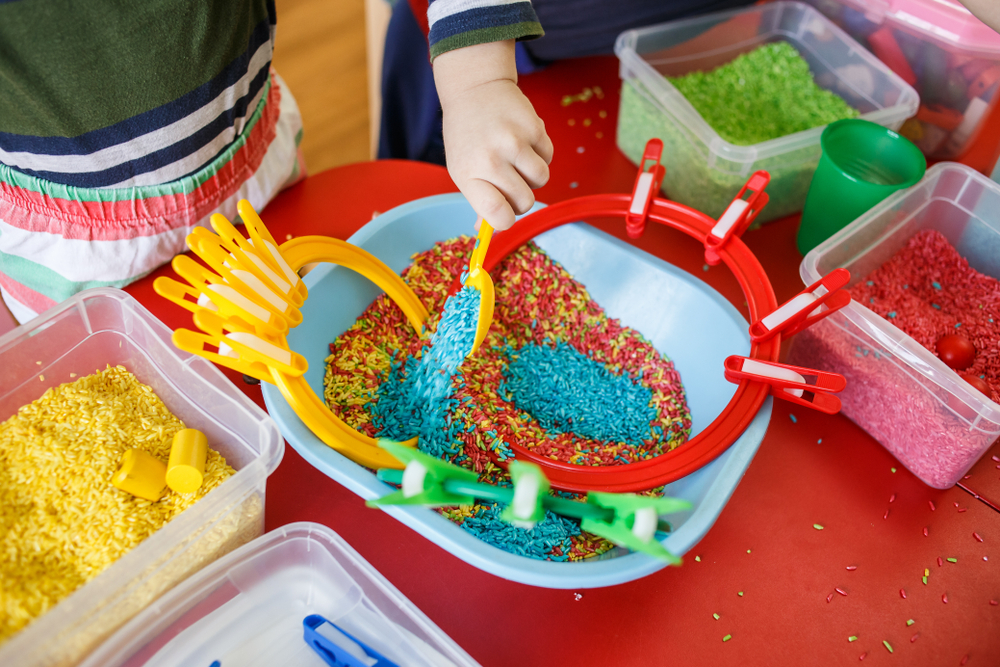 Kids can play with sensory bins while parents work from home