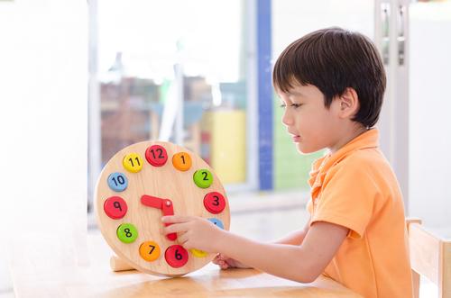 Child Holding a Clock