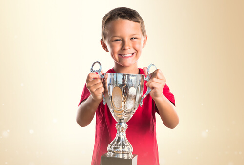 Kid Holding a Throphy