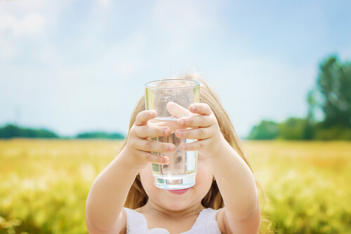 girl holding a glass of water