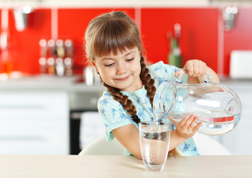 Kid Pouring Water