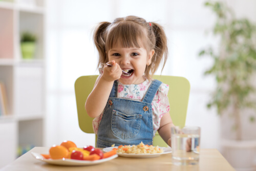 Child eating in the kitchen