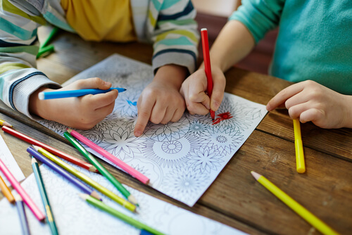 children drawing mandalas for art therapy