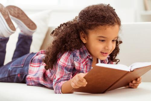 child using a dictionary to grow vocabulary