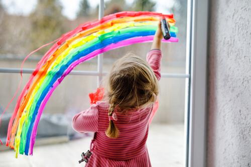 girl drawing a rainbow